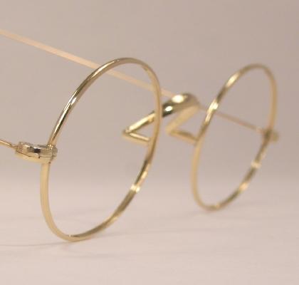 optometrist attic and company gold wire oval
